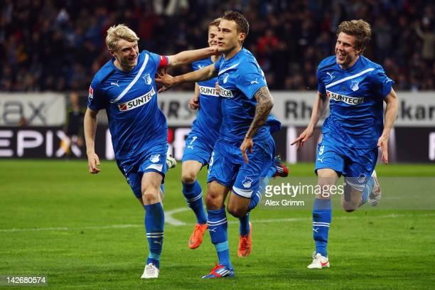 Fabian Johnson of Hoffenheim celebrates his team's third goal with team mates Andreas Beck Boris Vukcevic and Sven Schipplock during the Bundesliga...