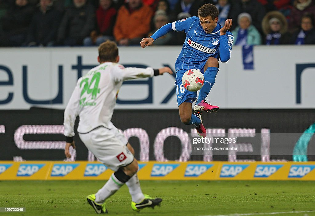Fabian Johnson (R) of Hoffenheim fights for the ball with Tony Janitschke (L) oh Moenchengladbach during the Bundesliga match between TSG 1899 Hoffenheim and VfL Borussia Moenchengladbach at Rhein-Neckar-Arena on January 19, 2013 in Sinsheim, Germany.