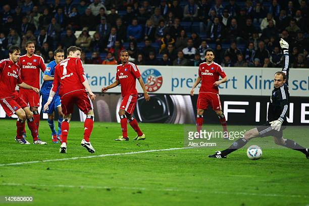 Fabian Johnson of Hoffenheim scores his team's third goal during the Bundesliga match between 1899 Hoffenheim and Hamburger SV at RheinNeckarArena on...