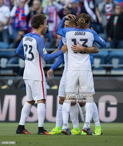 Fabian Johnson of Jermaine Jones and Clint Dempsey of the United States celebrate the first goal of their team scored by Clint Dempsey during a...