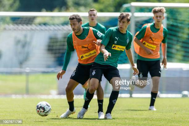 Fabian Johnson of Moenchengladbach and Florian Neuhaus of Moenchengladbach battle for the ball during the Borussia Moenchengladbach training camp on...
