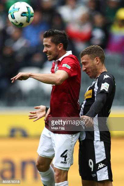 Fabian Johnson of Moenchengladbach and Julian Korb of Hannover battle for the ball during the Bundesliga match between Borussia Moenchengladbach and...