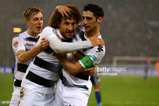 Fabian Johnson of Moenchengladbach celebrates the first goal with Patrick Herrmann and Lars Stindl of Moenchengladbach during the Bundesliga match...