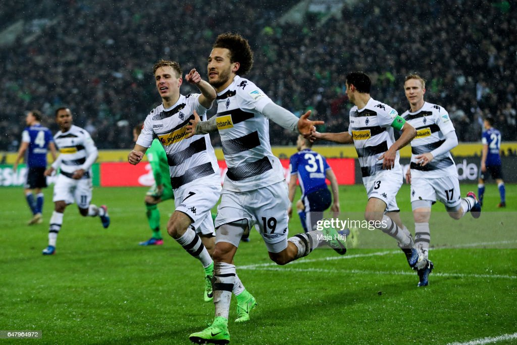 Fabian Johnson of Moenchengladbach (C) celebrates with his team-mates after scoring his team's second goal to make it 2-1 during the Bundesliga match between Borussia Moenchengladbach and FC Schalke 04 at Borussia-Park on March 4, 2017 in Moenchengladbach, Germany.