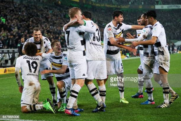 Fabian Johnson of Moenchengladbach celebrates with his teammates after scoring his team's second goal to make it 21 during the Bundesliga match...