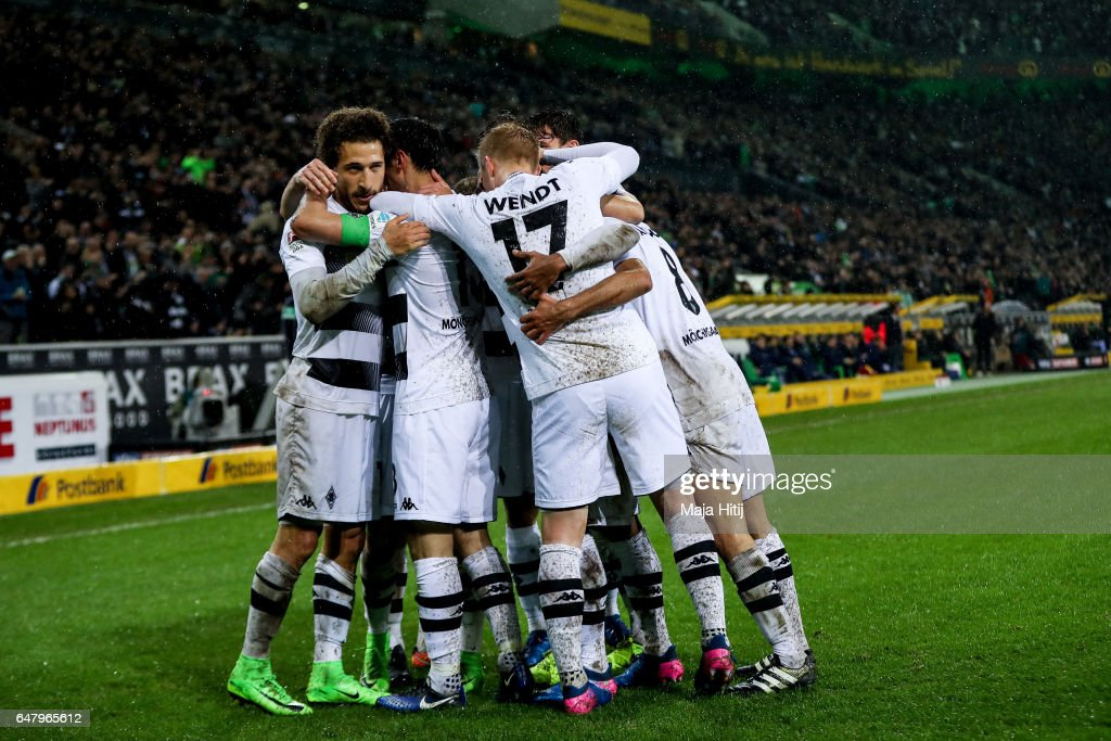 Fabian Johnson of Moenchengladbach (L) celebrates with his team-mates after scoring his team's second goal to make it 2-1 during the Bundesliga match between Borussia Moenchengladbach and FC Schalke 04 at Borussia-Park on March 4, 2017 in Moenchengladbach, Germany.