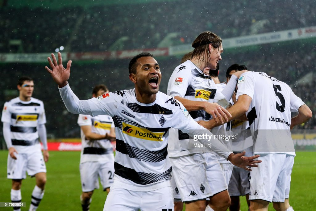 Fabian Johnson of Moenchengladbach (C) celebrates with his team-mates after scoring his team's forth goal to make it 4-1 during the Bundesliga match between Borussia Moenchengladbach and FC Schalke 04 at Borussia-Park on March 4, 2017 in Moenchengladbach, Germany.