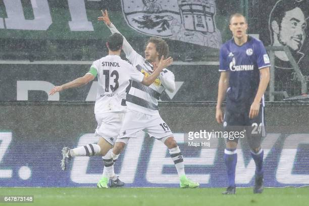 Fabian Johnson of Moenchengladbach celebrates with Lars Stindl after scoring a goal to make it 10 during the Bundesliga match between Borussia...
