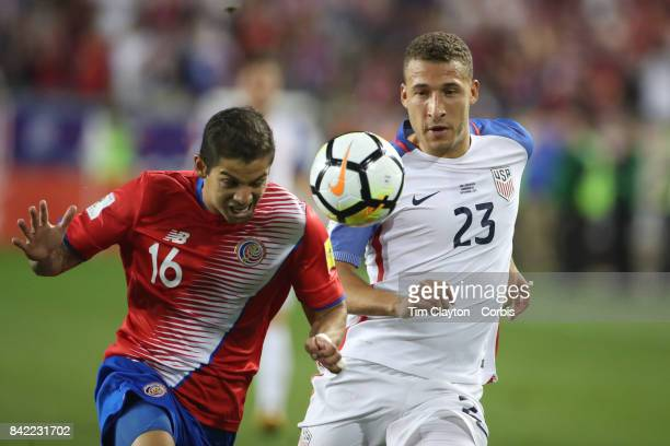Fabian Johnson of the United States and Cristian Gamboa of Costa Rica challenge for the ball during the United States Vs Costa Rica CONCACAF...