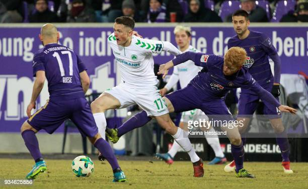 Fabian Kalig of Aue challenges Fabian Reese of Fuerth during the second Bundesliga match between FC Erzgebirge Aue and SpVgg Greuther Fuerth at...