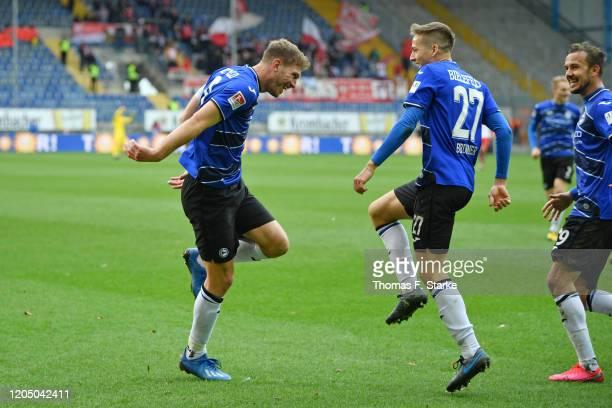 Fabian Klos and Cedric Brunner of Bielefeld celebrate during the Second Bundesliga match between DSC Arminia Bielefeld and SSV Jahn Regensburg at...