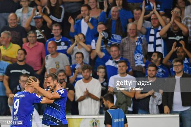 Fabian Klos and Manuel Prietl of Bielefeld celebrate during the Second Bundesliga match between DSC Arminia Bielefeld and FC St Pauli at Schueco...