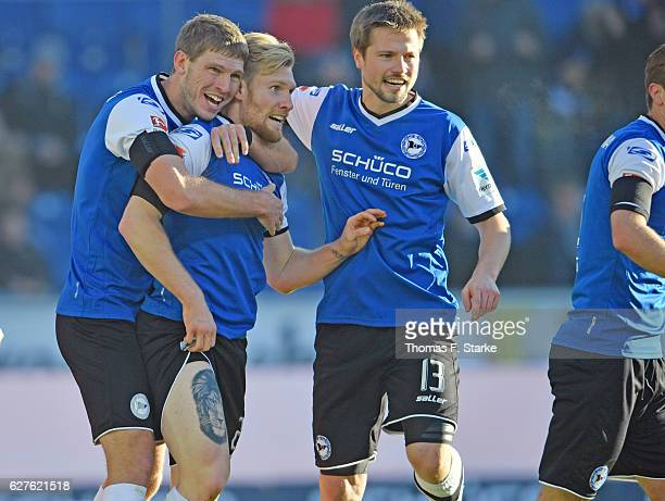 Fabian Klos Andreas Voglsammer and Julian Boerner of Bielefeld celebrate their teams first goal during the Second Bundesliga match between DSC...