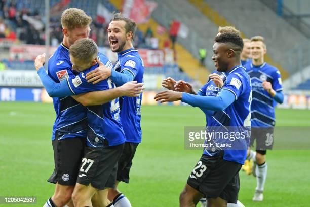 Fabian Klos Cedric Brunner Manuel Prietl and Anderson Lucoqui of Bielefeld celebrate during the Second Bundesliga match between DSC Arminia Bielefeld...