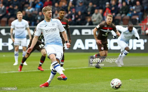 Fabian Klos of Arminia Bielefeld scores his team's first goal from a penalty during the Second Bundesliga match between FC St. Pauli and DSC Arminia...