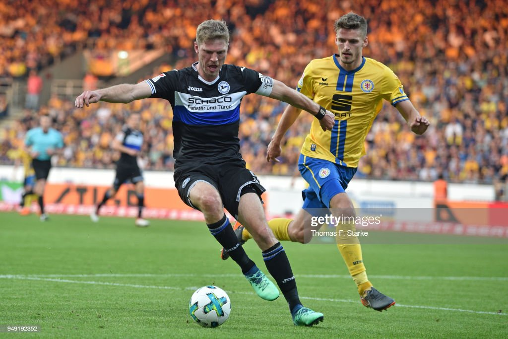 Fabian Klos (L) of Bielefeld and Gustav Valsvik of Braunschweig fight for the ball during the Second Bundesliga match between Eintracht Braunschweig and DSC Arminia Bielefeld at Eintracht Stadion on April 20, 2018 in Braunschweig, Germany.