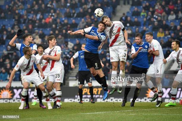 Fabian Klos of Bielefeld and Lasse Sobiech of St Pauli head for the ball during the Second Bundesliga match between DSC Arminia Bielefeld and FC St...