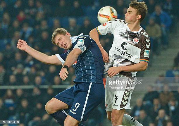 Fabian Klos of Bielefeld and Philipp Ziereis of St Pauli head for the ball during the Second Bundesliga match between Arminia Bielefeld and FC St...