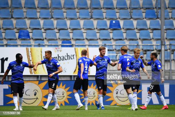Fabian Klos of Bielefeld celebrates his team's first goal with team mates during the Second Bundesliga match between DSC Arminia Bielefeld and VfL...
