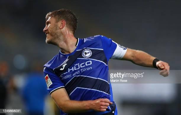 Fabian Klos of Bielefeld celebrates scoring his team's third goal during the Second Bundesliga match between DSC Arminia Bielefeld and SG Dynamo...