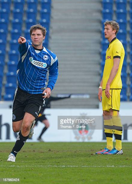 Fabian Klos of Bielefeld celebrates while Thomas Meissner of Dortmund looks dejected during the Third League match between Arminia Bielefeld and...