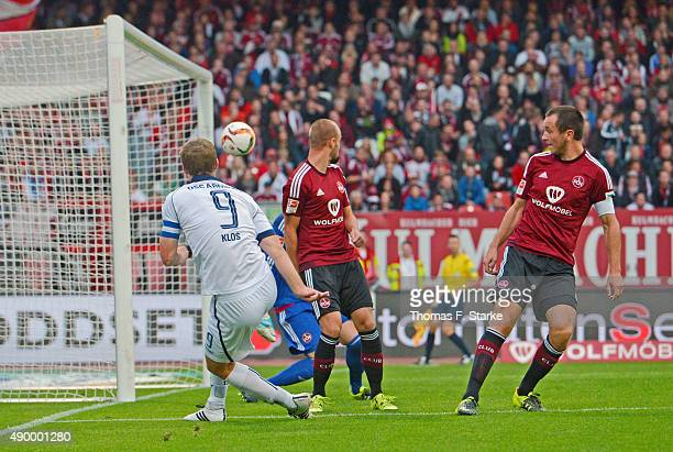 Fabian Klos of Bielefeld scores against Thorsten Kirschbaum Miso Brecko and Even Hovland of Nuernberg during the Second Bundesliga match between 1 FC...