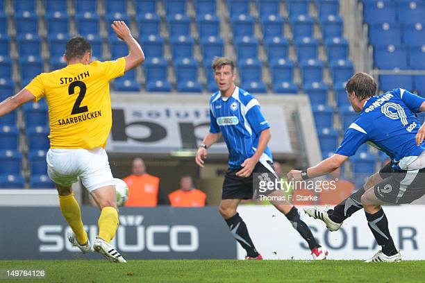 Fabian Klos of Bielefeld scores the winning goal pass Adam Straith of Saarbruecken during the Third League match between Arminia Bielefeld and 1 FC...
