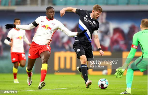 Fabian Klos of DSC Arminia Bielefeld scores his team's first goal during the Bundesliga match between RB Leipzig and DSC Arminia Bielefeld at Red...