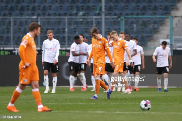 Fabian Kunze of Arminia Bielefeld looks dejected after Alassane Plea of Borussia Moenchengladbach scores his teams fifth goal during the Bundesliga...