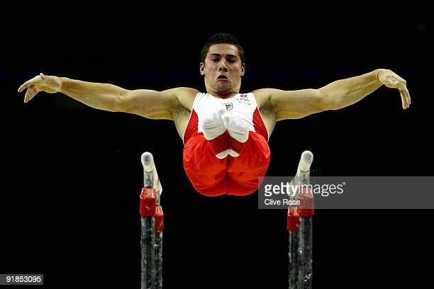 Fabian Leimlehner of Austria competes in the parallel bars during the Artistic Gymnastics World Championships 2009 at O2 Arena on October 13 2009 in...