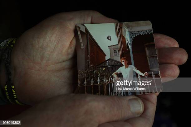 Fabian LoSchiavo a Mardi Gras 78er holds a photograph of himself from 1978 when he flew a pink flag from his home window in protest as seen on March...