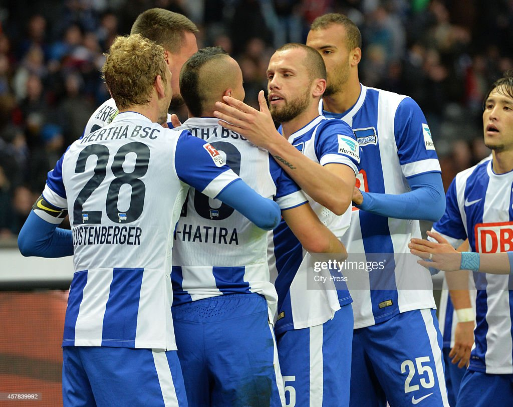 Fabian Lustenberger, Aenis Ben-Hatira and John Heitinga of Hertha BSC celebrate after scoring the 3:0 during the game between Hertha BSC and Hamburger SV on October 25, 2014 in Berlin, Germany.