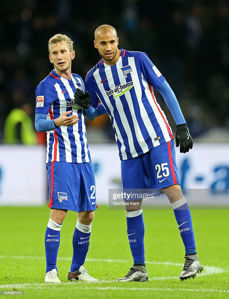 Fabian Lustenberger (L) and John Anthony Brooks (R) of Berlin look on after winning the Bundesliga match between Hertha BSC and Bayer Leverkusen at Olympiastadion on December 5, 2015 in Berlin, Germany.