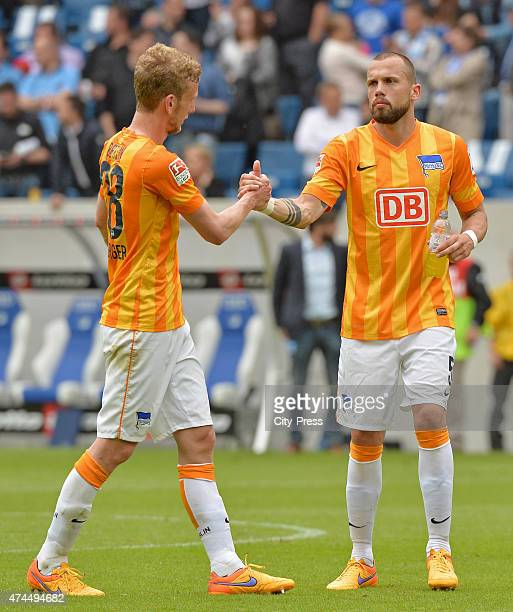 Fabian Lustenberger and John Heitinga of Hertha BSC exchange highfives during the game between TSG Hoffenheim and Hertha BSC on may 23 2015 in...