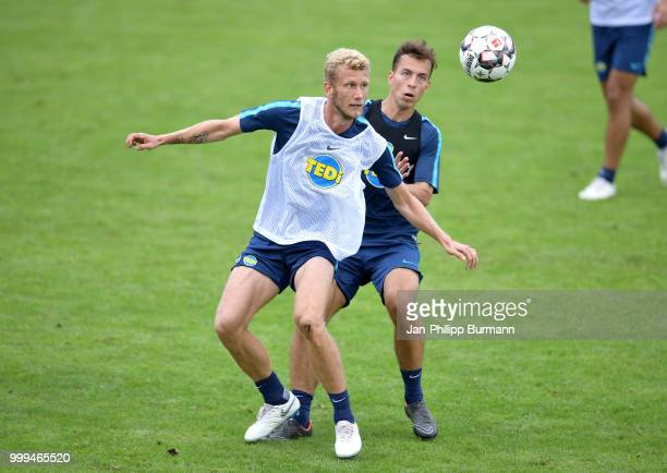 Fabian Lustenberger and Maximilian Pronichev of Hertha BSC during the training camp at VolksparkStadion on July 15 2018 in Neuruppin Germany