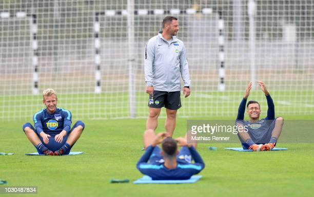Fabian Lustenberger coach Pal Dardai and Davie Selke of Hertha BSC during the training at the Schenkendorfplatz on September 10 2018 in Berlin Germany