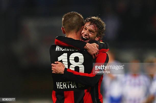 Fabian Lustenberger gives a hug to Artur Wichniarek of Hertha after the final whistle of the UEFA Europa League group D match between SC Heerenveen...