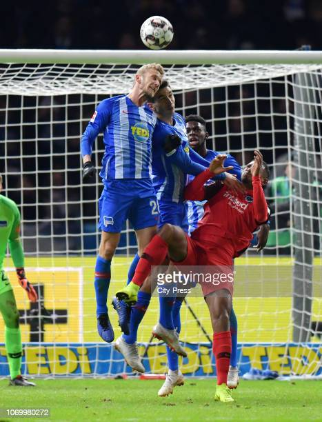 Fabian Lustenberger Marko Grujic Jordan Torunarigha of Hertha BSC and Sébastien Haller of Eintracht Frankfurt during the game between Hertha BSC and...