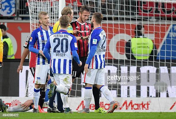 Fabian Lustenberger Mitchell Weiser of Hertha BSC referee Sascha Stegemann Thomas Pekhart of FC Ingolstadt 04 and Marvin Plattenhardt of Hertha BSC...