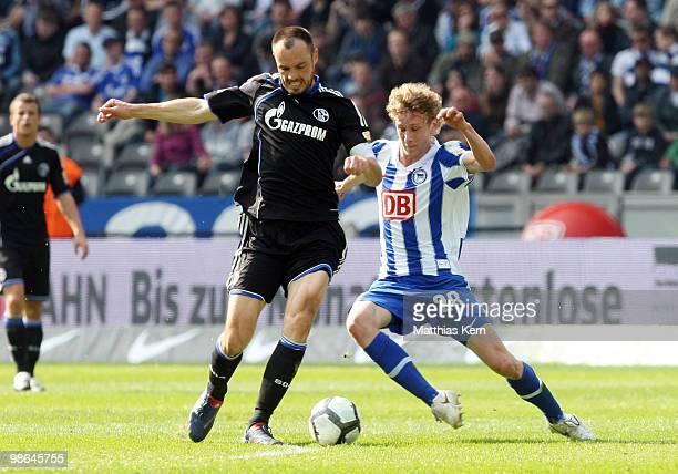 Fabian Lustenberger of Berlin battles for the ball with Heiko Westermann of Schalke during the Bundesliga match between Hertha BSC Berlin and FC...