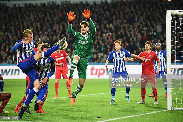 Fabian Lustenberger of Berlin has a shot saved by Ron Robrt Zieler of Hannover during the Bundesliga match between Hannover 96 and Hertha BSC at...