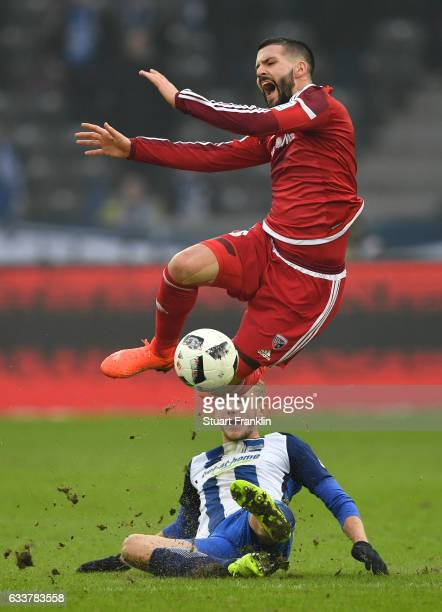 Fabian Lustenberger of Berlin is challenged by Anthony Jung of Ingolstadt during the Bundesliga match between Hertha BSC and FC Ingolstadt 04 at...