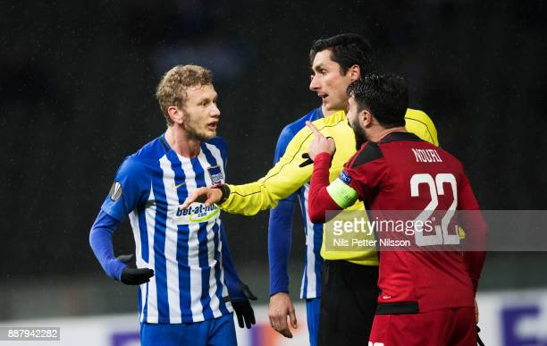 Fabian Lustenberger of Herta Berlin SC and Brwa Nouri of Ostersunds FK has an argument during the UEFA Europa League group J match between Hertha BSC...