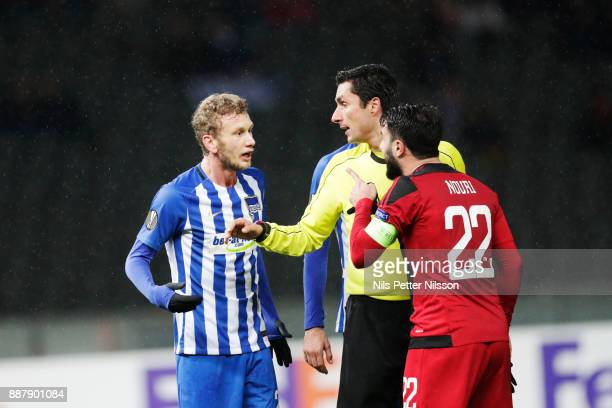 Fabian Lustenberger of Hertha Berlin SC in arguments with Brwa Nouri of Ostersunds FK during the UEFA Europa League group J match between Hertha BSC...