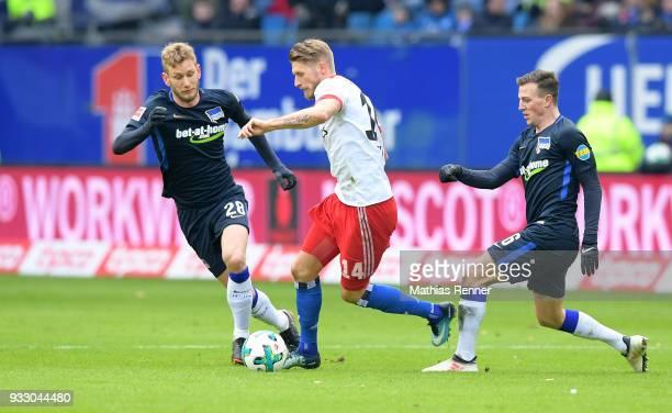 Fabian Lustenberger of Hertha BSC Aaron Hunt of Hamburger SV and Vladimir Darida of Hertha BSC during the Bundesliga game between Hamburger SV and...