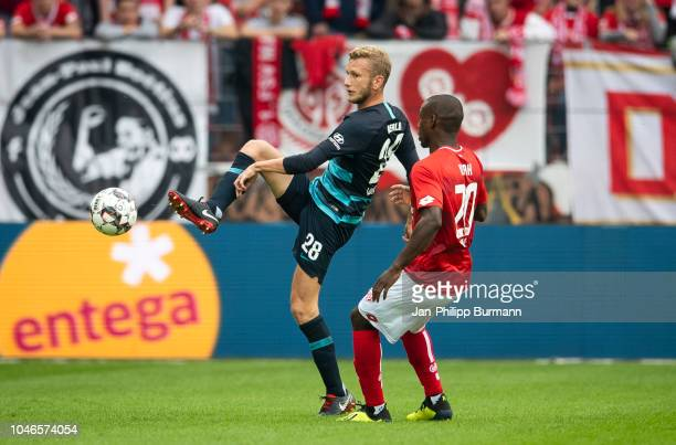 Fabian Lustenberger of Hertha BSC and Anthony Ujah of FSV Mainz 05 during the Bundesliga match between FSV Mainz 05 and Hertha BSC at OpelArena on...