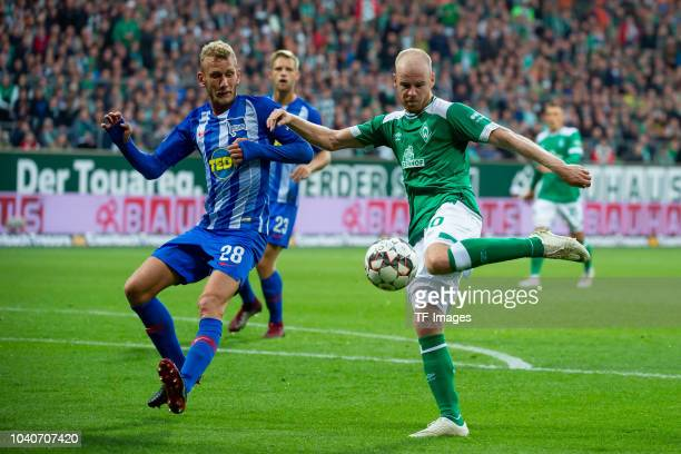 Fabian Lustenberger of Hertha BSC and Davy Klaassen of Werder Bremen battle for the ball during the Bundesliga match between SV Werder Bremen and...