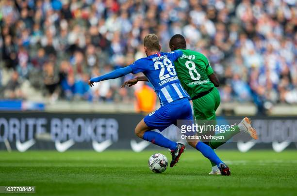 Fabian Lustenberger of Hertha BSC and Denis Zakaria of Borussia Moenchengladbach battle for the ball during the Bundesliga match between Hertha BSC...