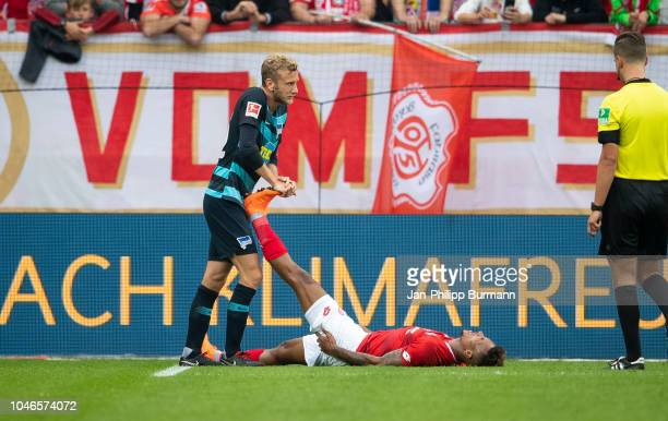 Fabian Lustenberger of Hertha BSC and JeanPhilippe Gbamin of FSV Mainz 05 during the Bundesliga match between FSV Mainz 05 and Hertha BSC at...