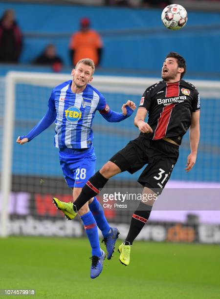 Fabian Lustenberger of Hertha BSC and Kevin Volland of Bayer 04 Leverkusen during the Bundesliga match between Bayer 04 Leverkusen and Hertha BSC at...